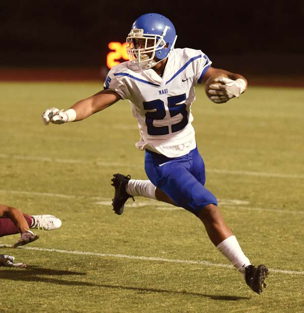 Maui High's Solomone Tongi runs with the ball in the second quarter Friday -- The Maui News / MATTHEW THAYER photo