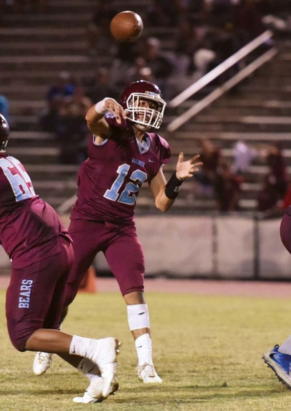 The Bears' Chayce Akaka throws a touchdown pass. -- The Maui News / MATTHEW THAYER photo