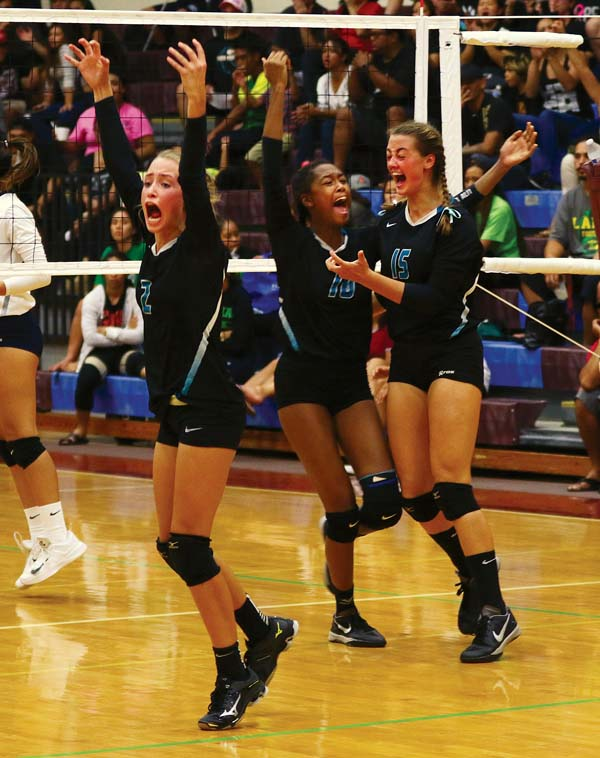 King Kekaulike's (from left) Lauren Albrecht, Lyric Love and Brooklynne Albrecht celebrate a point in the first set Friday. -- The Maui News / CHRIS SUGIDONO photo