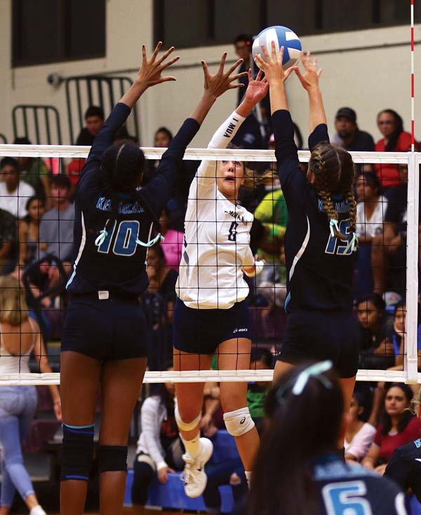 Kamehameha Maui's Talia Leauanae hits against Love and Albrecht in the first set.  -- The Maui News / CHRIS SUGIDONO photo