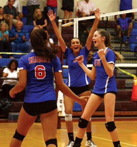 Seabury Hall's Ella Connor celebrates alongside Kiana Hyman (6) and Isabel Bennett after the Spartans finished off a four-set victory over Hana on Friday night. -- The Maui News / CHRIS SUGIDONO photo