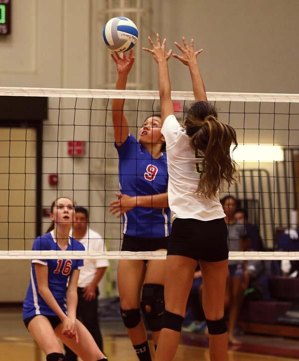 The Spartans' Erica Pilotin hits past Hana's Noho Lind in the third set. -- The Maui News / CHRIS SUGIDONO photo