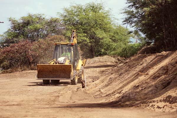 A bulldozer grades a vacant dirt lot next to Home Maid Bakery in Wailuku on Tuesday morning. -- The Maui News / COLLEEN UECHI photo