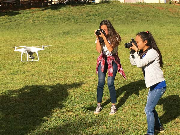 Kokoro Yamazaki and Aki Foreman photograph a drone in flight in May at Lahaina Intermediate School's STEMworks AFTERschool program. The free program is requesting donations of snacks for the youths. -- STEMworks AFTERschool photo