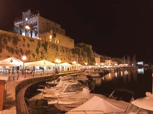 Boats docked in front of a restaurant-lined street (above) in Port Mahon, on the island of Menorca, Spain. -- AP photo