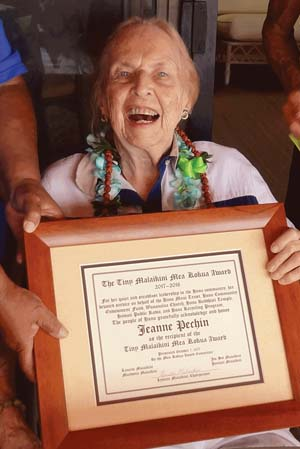 Jeanne Pechin is shown at her home with the framed certificate recognizing her as the 2017 Tiny Malaikini Mea Kokua Award winner. -- WARD MARDFIN photo