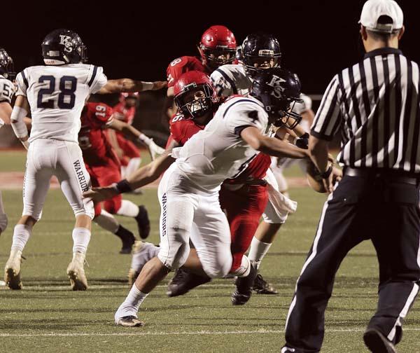 Elijah Moritz of Lahainaluna sacks Kamehameha Maui quarterback Kainoa Sanchez in the second quarter. -- The Maui News / CHRIS SUGIDONO photo