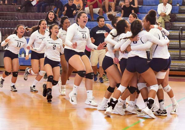 Kamehameha Maui's bench storms the court after the final point of the team's five-set, MIL championship-clinching win over King Kekaulike on Saturday.  -- The Maui News / MATTHEW THAYER photo