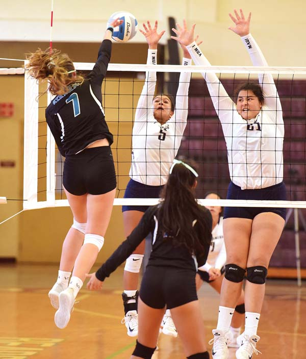 The Warriors' Tatiana Martinez (right) and Aliah Ayau put up a block against Na Alii's Chandler Cowell in the fourth set. -- The Maui News / MATTHEW THAYER photo