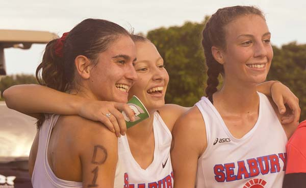 Seabury Hall teammates (from left) Veronica Winham, Bella Lallo and Maile Dougherty celebrate after the Spartans won a 12th consecutive Maui Interscholastic League championship Saturday in Kapalua. -- The Maui News / BRAD SHERMAN photo