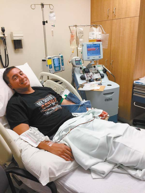 """Wearing a T-shirt that reads """"My sister's battle is my battle,"""" Wailuku EMT Wayne Segundo donates stem cells at the Kapiolani Medical Center for Women & Children on Oahu in March. The donation went to a 39-year-old cancer patient in Australia whom Segundo calls his """"future sister."""" Photos courtesy of Wayne Segundo"""