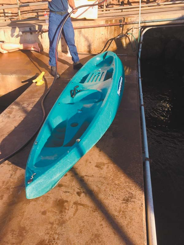 """This blue kayak with a """"Spectrum"""" label on it was found unmanned and adrift Sunday morning approximately 500 yards off Maalaea Harbor. Anyone with information on the kayak's owner should contact the U.S. Coast Guard Sector Honolulu at (808) 842-2600. U.S. Coast Guard photo"""