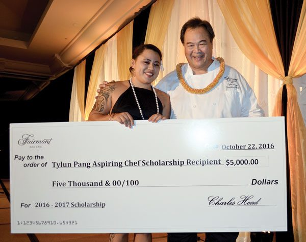 The 2016 Tylun Pang Aspiring Chef Scholarship winner Tatiana Kaniaupio (at left) accepts a $5,000 check from the Fairmont Kea Lani chef himself, a humble man who so generously takes on a student at his resort to learn the ropes in an eight-week-long kitchen adventure each year. Photo courtesy UH-Maui College