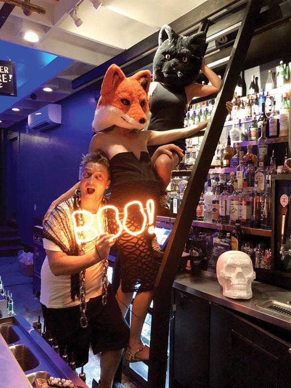 "Wai Bar's Johnny Wilson says ""boo"" as foxy wife Amanda and kitty Michelle Halcomb climb the liquor ladder. TRISH EDSTROM photo"
