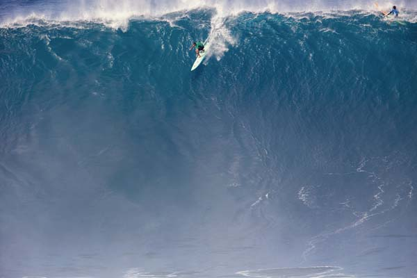 Ian Walsh drops down the face of a massive wave.  -- World Surf League / KEOKI SAGUIBO photo