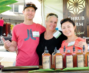Joshua Kramer (left) and wife Tomomi Kramer of Maui Shrub Farm flanking helper Ann Tuomelo -- Photo courtesy Made in Maui County Festival