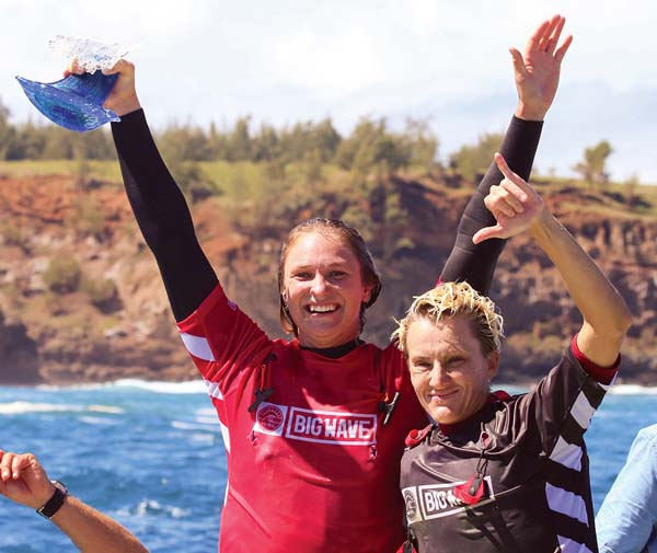 Women's champion Paige Alms celebrates with runner-up Keala Kennelly. -- World Surf League photo / RICHARD HALLMAN