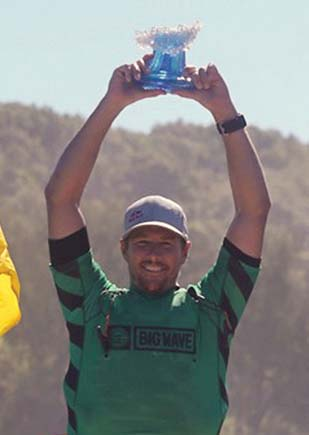 Ian Walsh holds his trophy. -- World Surf League photo / RICHARD HALLMAN