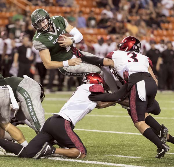 Hawaii quarterback Dru Brown dives into the end zone for a touchdown during the second quarter Saturday. -- AP photo
