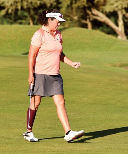 Lisa Judge reacts after sinking a birdie putt on Maui Country Club's second hole during the Lester Hamai Memorial on Saturday. -- The Maui News / MATTHEW THAYER photo