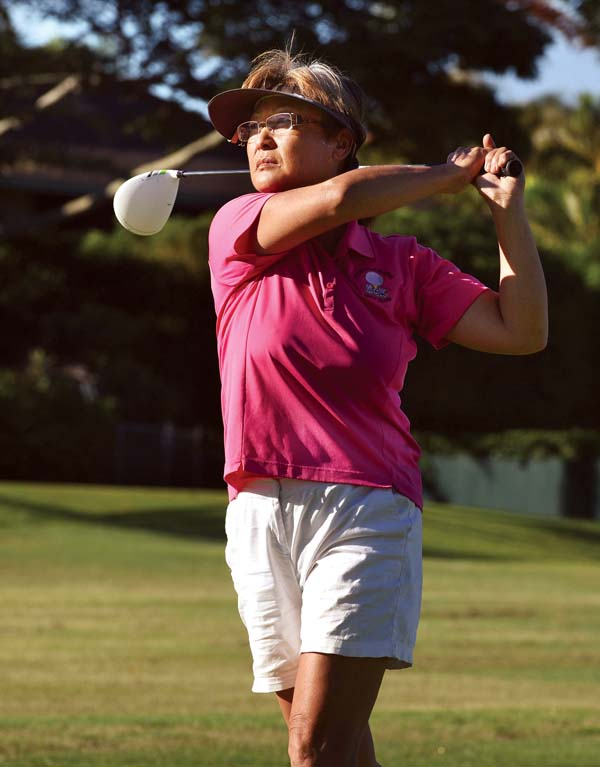 Amy Nelson follows the flight of her shot off the fourth tee. -- The Maui News / MATTHEW THAYER photo
