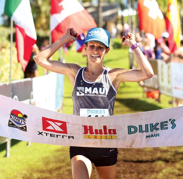 "Malia Crouse crosses the finish line to win the Duke's Beach House 10K on Saturday. Crouse covered the course, which began and ended at The Ritz-Carlton, Kapalua, in 47 minutes, 38 seconds. ""I had so much fun out there,"" Crouse said. ""I just loved that course."" The 10K was one of multiple trail runs that took place in conjunction with today's Xterra World Championship tri­athlon. -- The Maui News / CHRIS SUGIDONO photo"