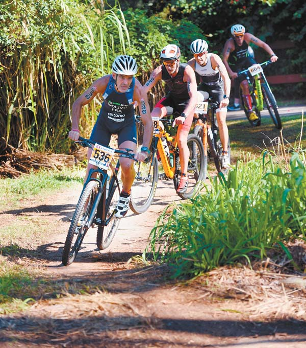 Fred D. Olivo leads a pack of competitors at the start of the mountain-bike leg.