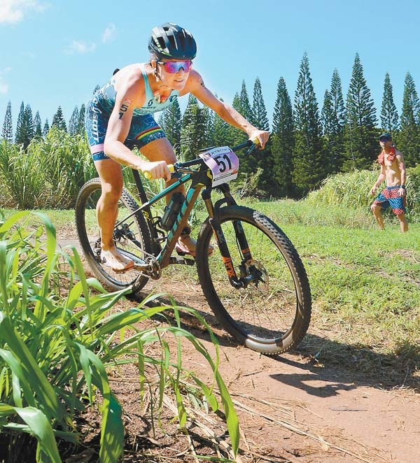 Flora Duffy competes in the mountain-bike leg on the way to claiming a fourth consecutive women's championship.