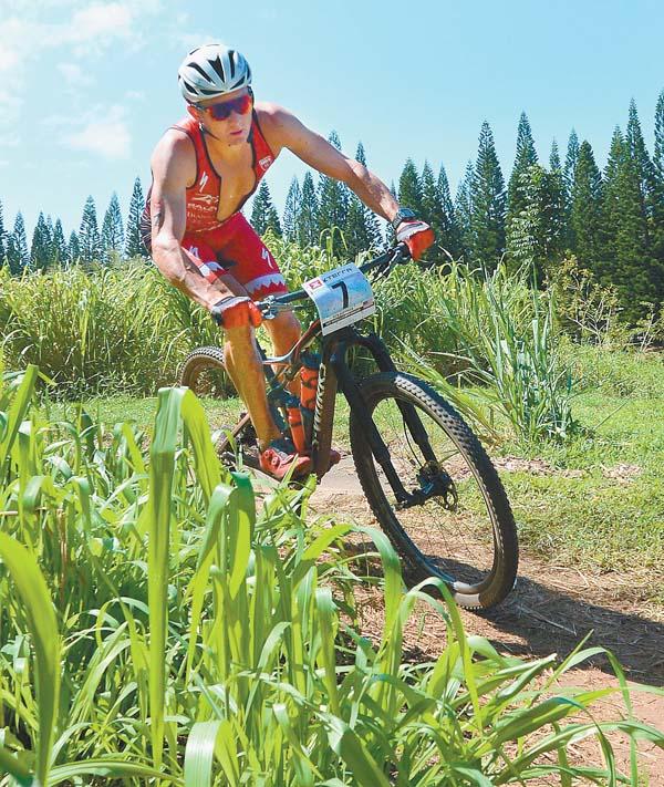 Third-place finisher Ruben Ruzafa nears the end of the bicycle leg.