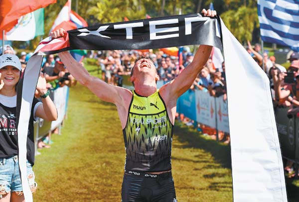 Bradley Weiss celebrates Sunday after being the first to arrive at the Xterra Off-Road World Championship Triathlon finish line at the Ritz-Carlton, Kapalua. The Maui News / MATTHEW THAYER photos
