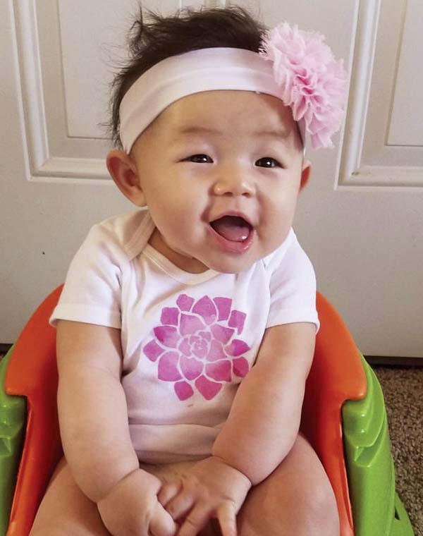 Jordyn Habu, 6 months old, models her aunty Patricia Huntley's hand-painted onesie. Huntley's baby products under the Hapa Maui Designs label will be one of the more than 140 vendors featured at the Made in Maui County Festival on Friday and Saturday at the Maui Arts & Cultural Center.