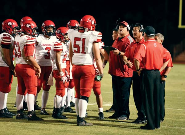 Lahainaluna coaches and players, shown during a game in September, will try to end a three-game losing streak against Iolani in the state tournament.