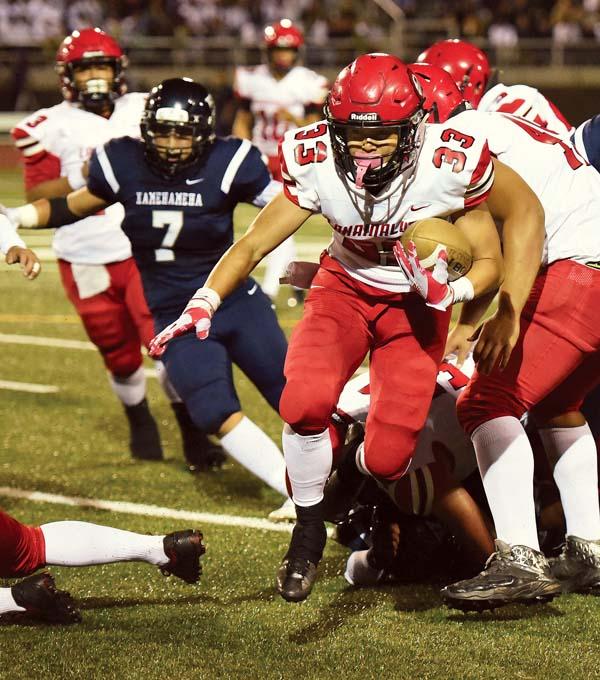 Joshua Tihada ran for 599 yards and nine touchdowns for Lahainaluna High School during the Maui Interscholastic League season. The Maui News / MATTHEW THAYER photos