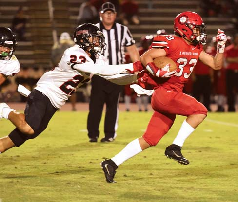 Lahainaluna High School's Joshua Tihada tries to elude Iolani's Lanakila Pei during the first quarter of the Lunas' 35-27 win over the Raiders on Friday in a First Hawaiian Bank Division II State Football Championship semifinal game at War Memorial Stadium. -- The Maui News / MATTHEW THAYER photo