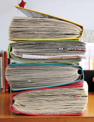 A stack of filled journals  -- Photo via AP