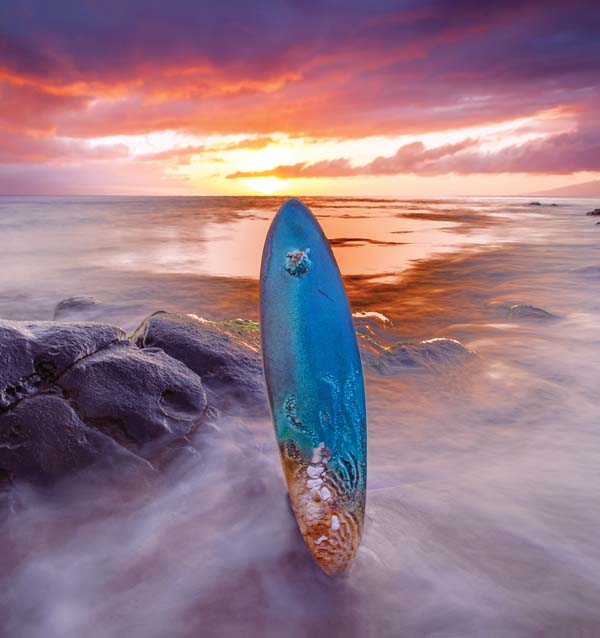 Lee Oululani Plevney adorns a ceramic surfboard with a honu, or turtle. -- Lightsavor Photography / SCOTT DAVIDSON photo