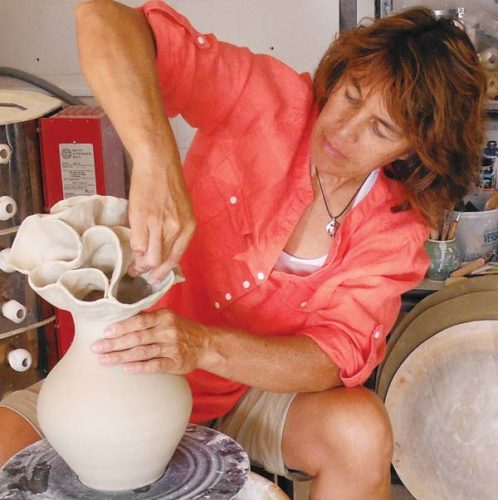 Ceramicist Lee Oululani Plevney at work in her studio. -- BETTY PLEVNEY photo