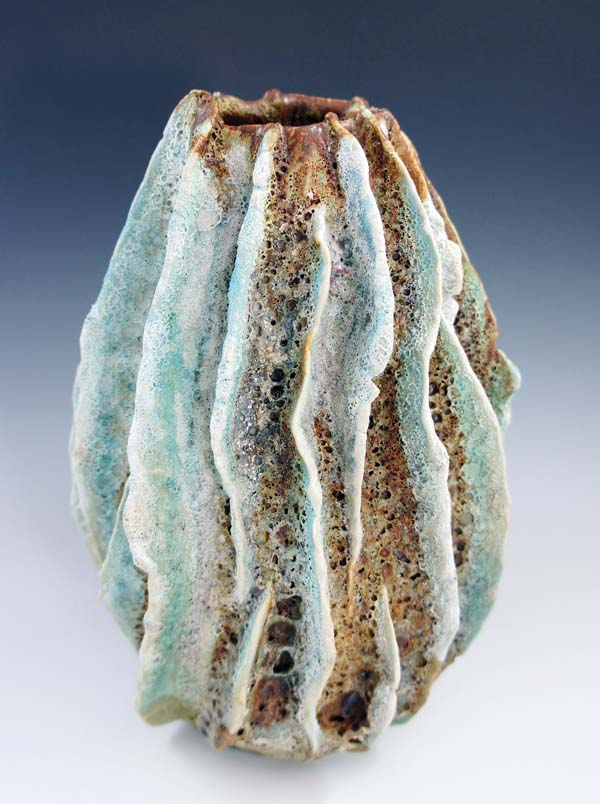 "Lee Oululani Plevney uses her special lava glaze on  ""Lave Tube 1 - Breathing Hole for the Earth's Soul"" which creates exploding air pockets within the glaze evoking the breath of Pele. -- BETTY PLEVNEY photo"