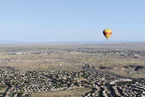 A hot-air balloon flies over the Rio Grande  Valley. -- APphoto