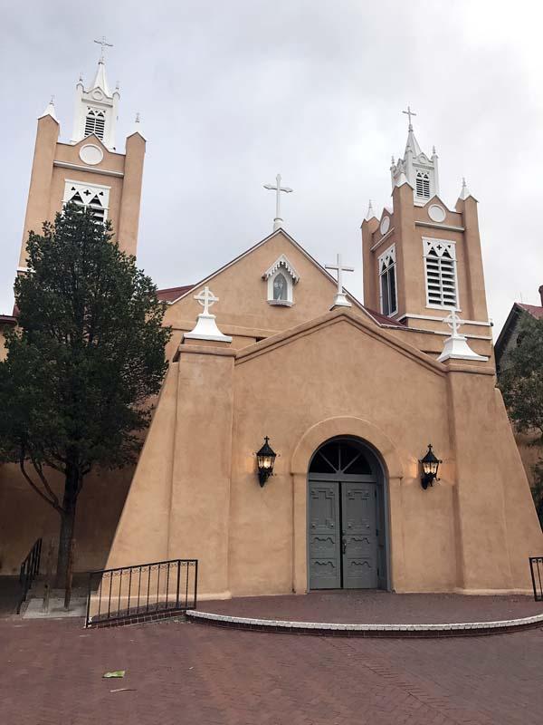The facade of the 18th century San Felipe de Neri Church in downtown Albuquerque. -- APphoto