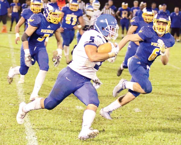 Maui High School's Naia Nakamoto heads upfield on the way to a touchdown in the second quarter of the Sabers' 26-7 loss to Hilo on Saturday in a First Hawaiian Bank Division I State Championship semifinal game at Wong Stadium. -- Hawaii Tribune-Herald / TIM WRIGHT photo