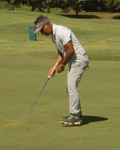 Raymond Tendo sinks a putt during the Maui Country Club championship Saturday. -- The Maui News / JOEBRADLEY photo