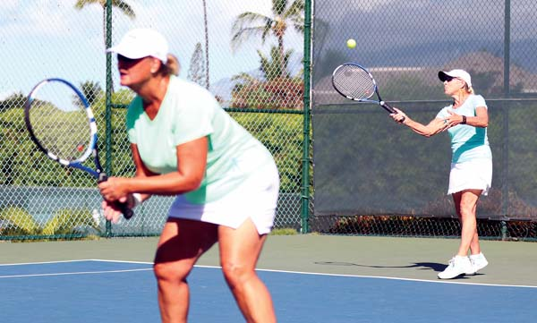 Anneliese Stoinski serves behind fellow Kihei resident Donna Barker during a Wailea Fall Doubles women's 6.0 match Saturday at the Wailea Tennis Club. The tournament, which concludes today, is serving as a fundraiser for the Semper Fi Fund, which provides assistant to ill and injured members of all branches of the U.S. forces and their families. -- The Maui News / CHRIS SUGIDONO photo
