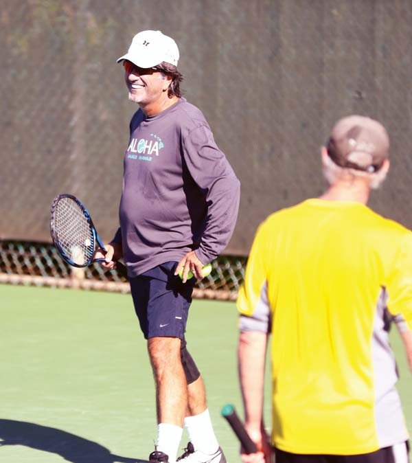 Curt deCrinis smiles after he and fellow Makawao resident Phil Peterson won a point in a men's 9.0 match. -- The Maui News / CHRIS SUGIDONO photo
