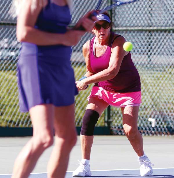 Vika Fittsmilgrim returns a shot behind fellow Kihei resident Vicki D'Annunzio during a women's 6.0 match. -- The Maui News / CHRIS SUGIDONO photo