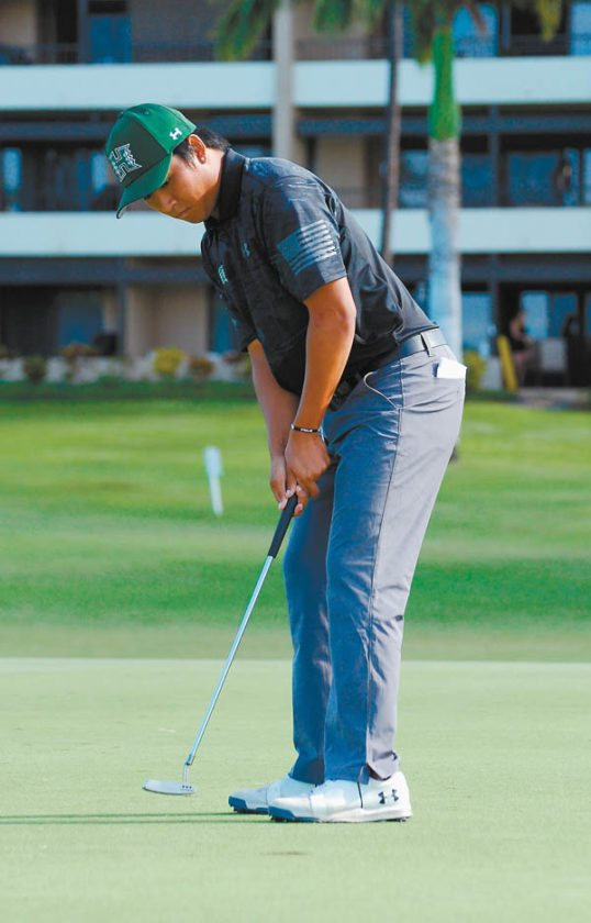 Hawaii's Justin Arcano sinks a birdie putt on the 16th hole. MELISSA DUPUIS photo