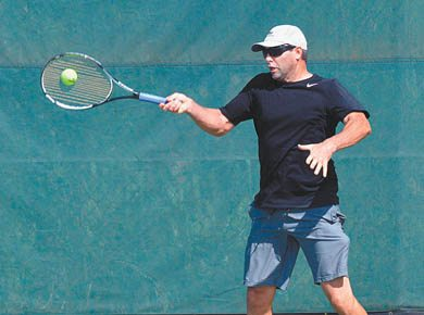 Eric Lawrence hits a return during a 2-6, 7-6, 10-6 win for him and Brayden Corniel over Devon Baldwin and John Deinhardt in a Wailea Fall Doubles men's 9.0 match Sunday at the Wailea Tennis Club. The tournament served as a benefit for the Semper Fi Fund, and more than $25,000 was raised through entry fees, a silent auction, sponsorships and donations to help ill and injured members of all branches of the U.S. armed forces and their families. The Maui News / BRAD SHERMAN photo