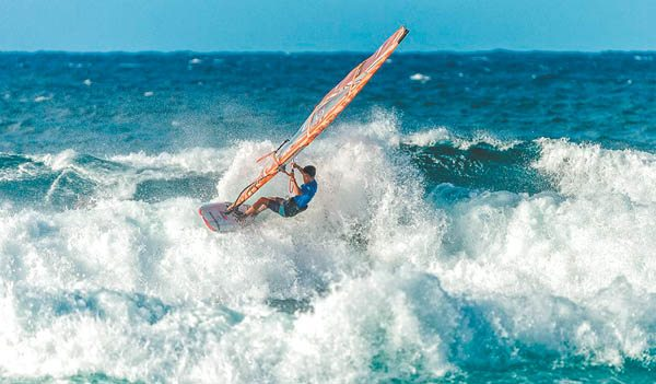 Ishii Ta­kara rides a wave en route to winning the Aloha Classic youth title Sunday at Hookipa Beach Park. International Windsurfing Tour / SI CROWTHER photo
