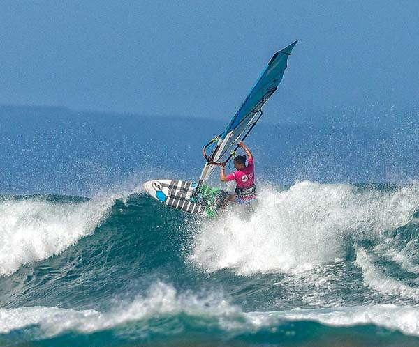 Sarah Hauser rides a wave during her win in a women's pro third-round heat.