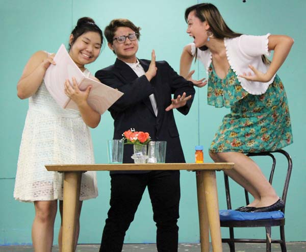 "Erin Tsue (from left), Jaysen Giroux and Lauryn Ige go on the worst first dates in history in the Baldwin Performing Arts Learning Center and Theatre Guild's production of the comedy ""Check, Please!"" Ray-Anne Dela Cruz photo"